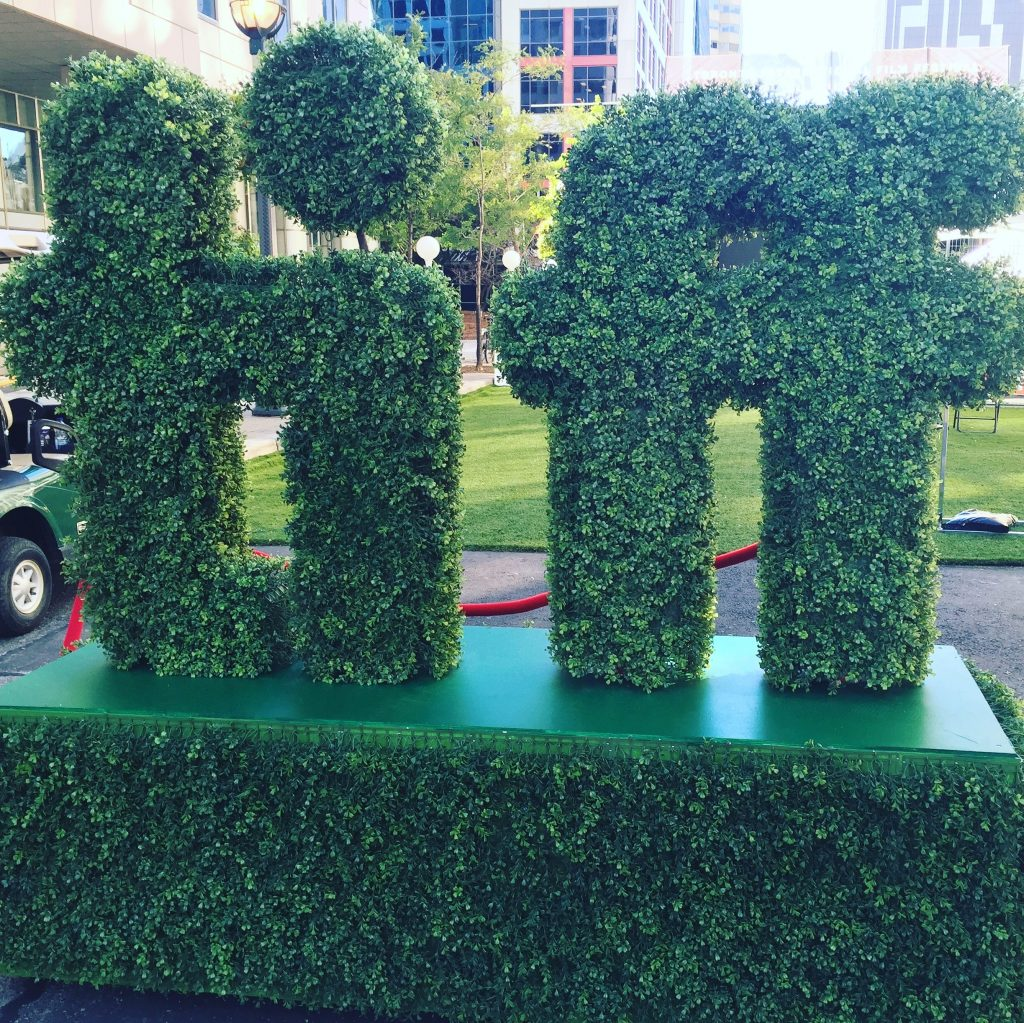 Toronto International Film Festival sign made out of greenery outside of Metro Hall