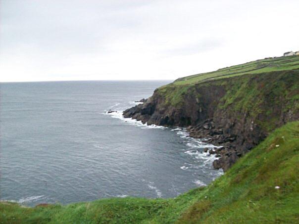 A cliff overlooking the ocean in Ireland.