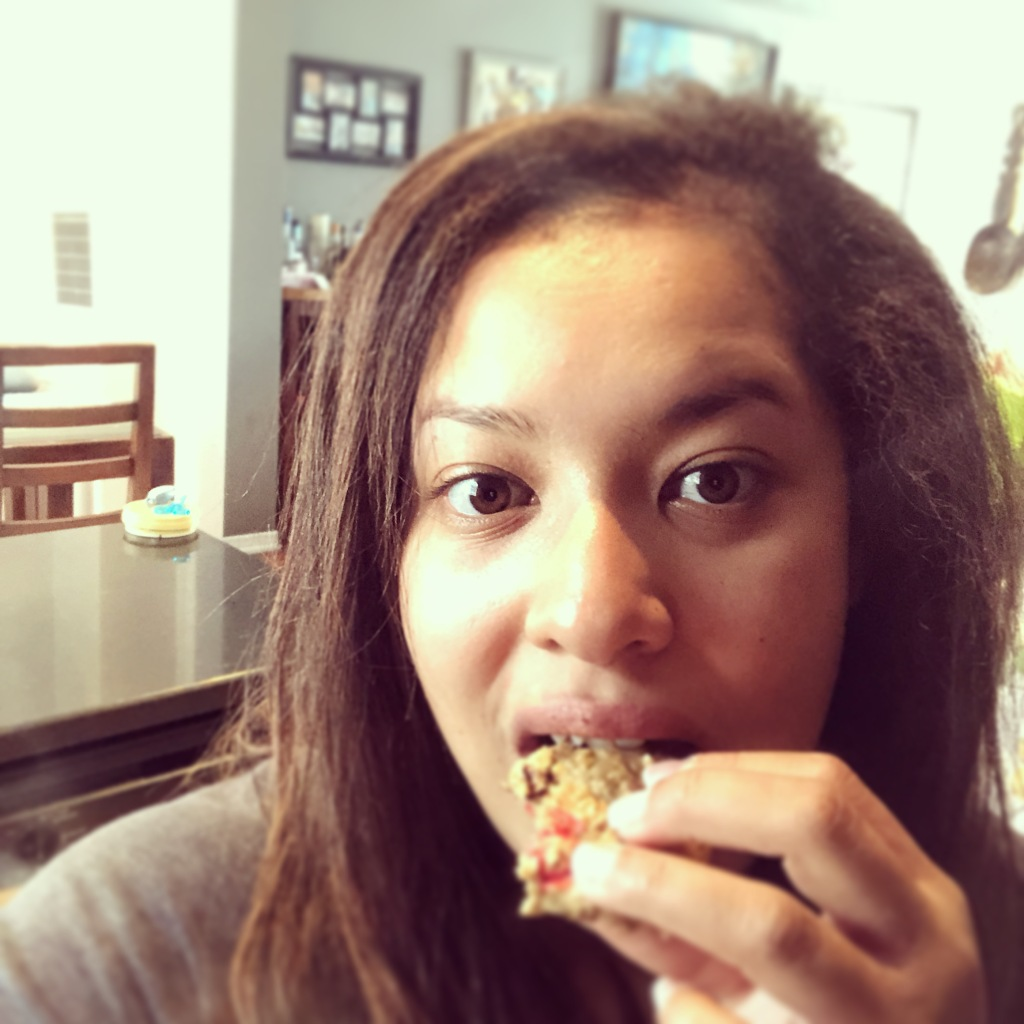 Author eating a cookie and looking at the camera.