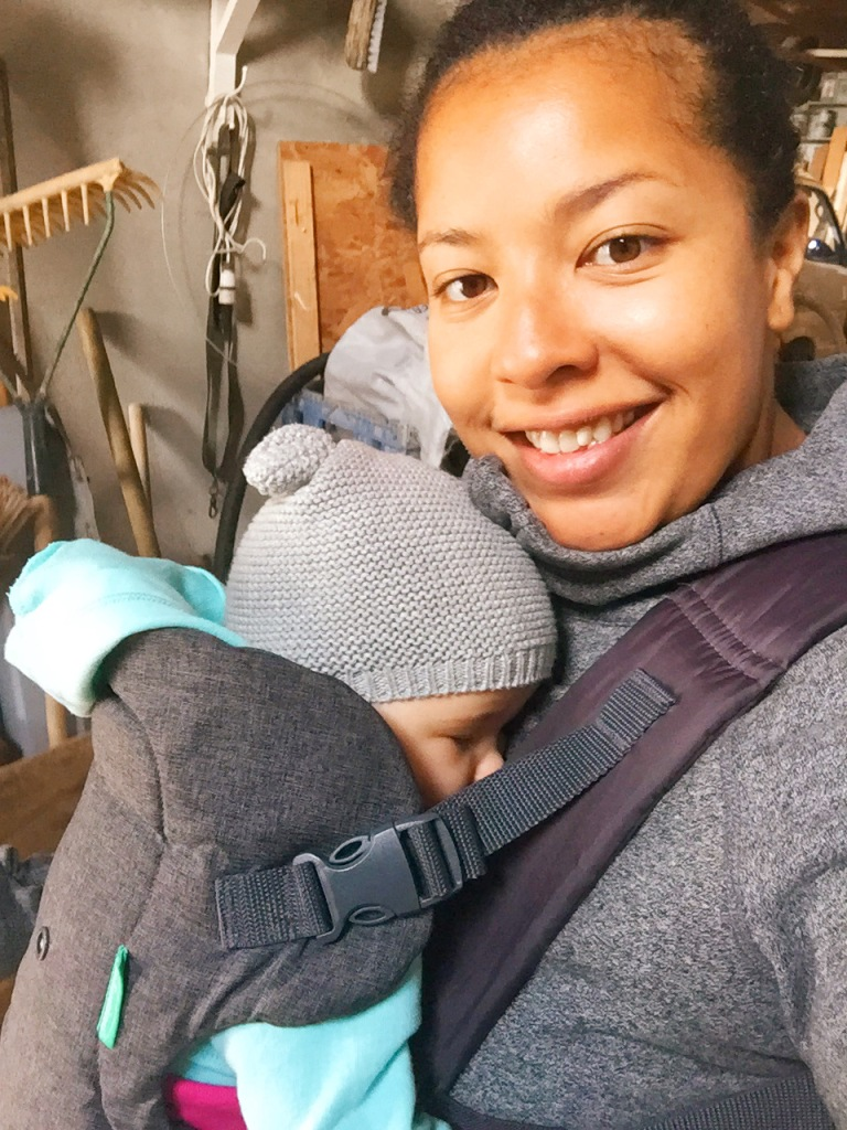 Author with baby in carrier.